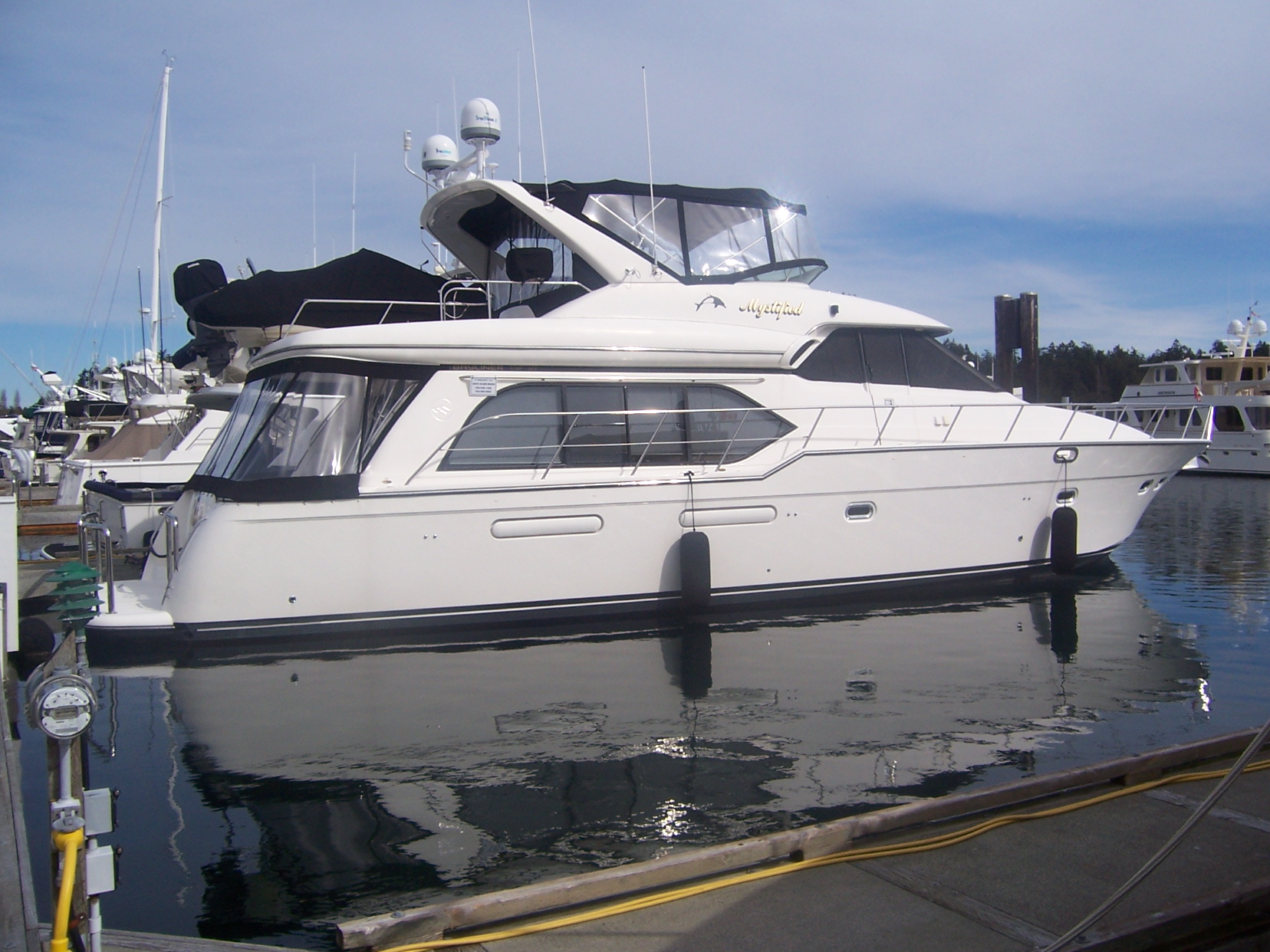 """... completed the sale of a 57' 5788 Bayliner Pilothouse 1999 """"Mystified""""."""